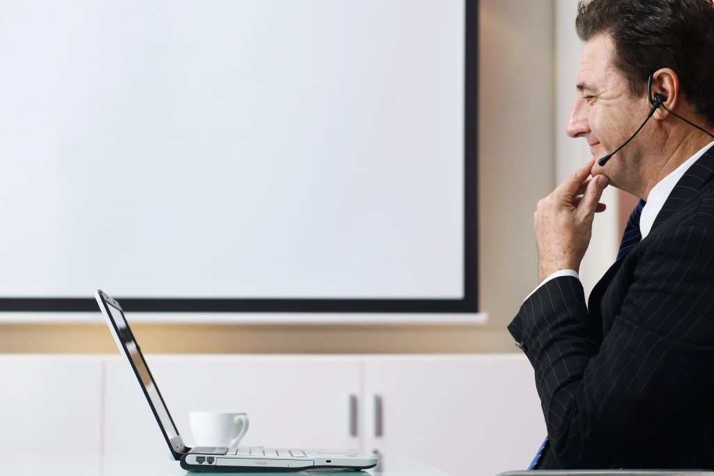 Business man watching video on laptop from Web Video Production