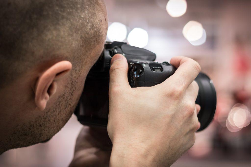 Man using camera.